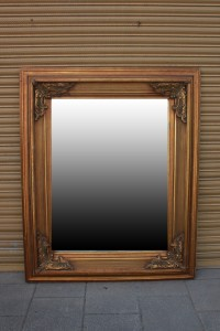 We have a lovely large wooden gilt framed beveled edge mirror in beautiful condition. I would recommend a solid wall when hanging, although the mirror would also look great stood on end either as a dress mirror or in a retail environment.  £300 Dimensions: 138cm wide                        170cm high
