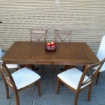 Oak extending dining table in very good condition with six matching chairs. £200