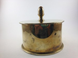 We have a 1917 heavy brass tobacco container stamped 1917 Dusseldorf, made from a German shell.12,cm - 7,cm  £!50. We can post for a small fee