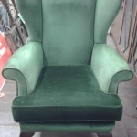 Parker knoll style bottle green winged arm chair in lovely condition. £80