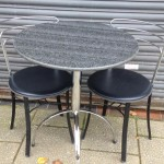 Ex John Lewis granite top 690,cm circular table with two matching chrome and leather chairs in excellent condition. £50
