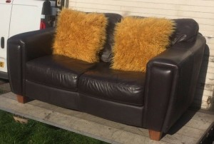 Hopewells real leather ttwo seater sofa with a single matching chair and foot stool that also acts a storage cube £200