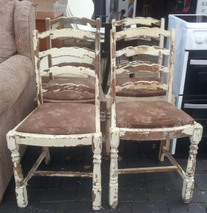 Four matching oak ladder back chairs. Easy to strip back and would make an ideal shabby chic / up-cycle project £50