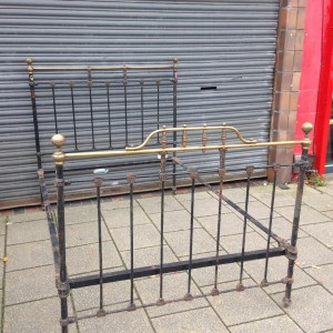 Antique brass and iron double bed complete with original pot casters although one is missing but can be sourced via the net. also comes with side rails and wooden slats. £200